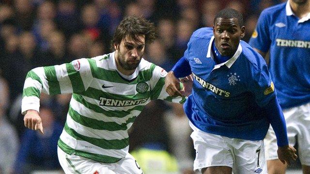 Georgios Samaras and Maurice Edu tussle for possession