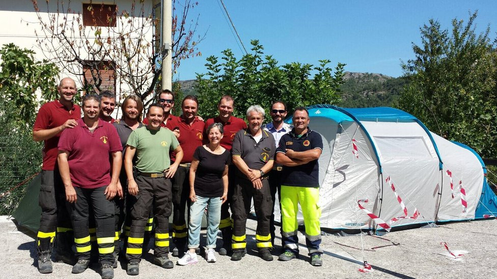 Maddalena with the Modena firefighters who set up a tent for her just after the quake