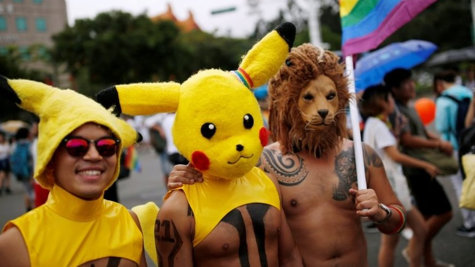 Participants wearing hats of a Pokemon character, Pikachu, take part gay pride parade in Taipei, Taiwan on 29 October 2016