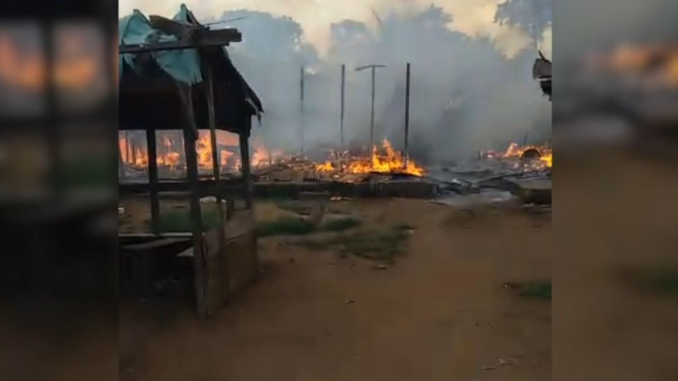 The village of Kuke Mbomo seen on fire