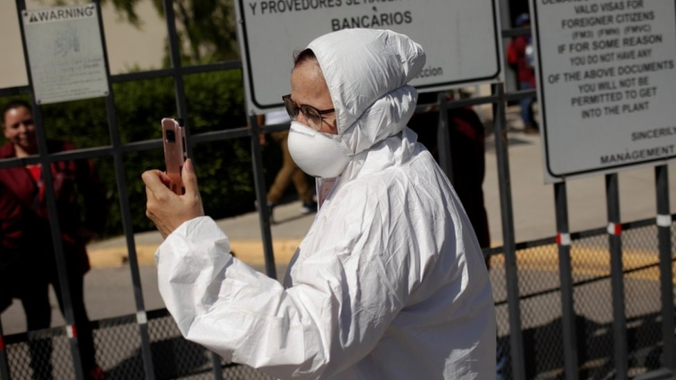 Susana Prieto, a lawyer and labour activist, is seen outside of a factory during a protest