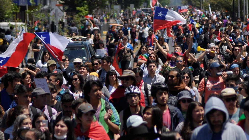 Demonstrators march against Chile's government in Concepcion, Chile, 12 November, 2019.
