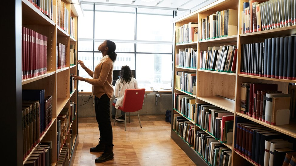 Students search the shelves at a university library