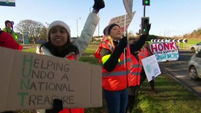 Junior doctors holding placards