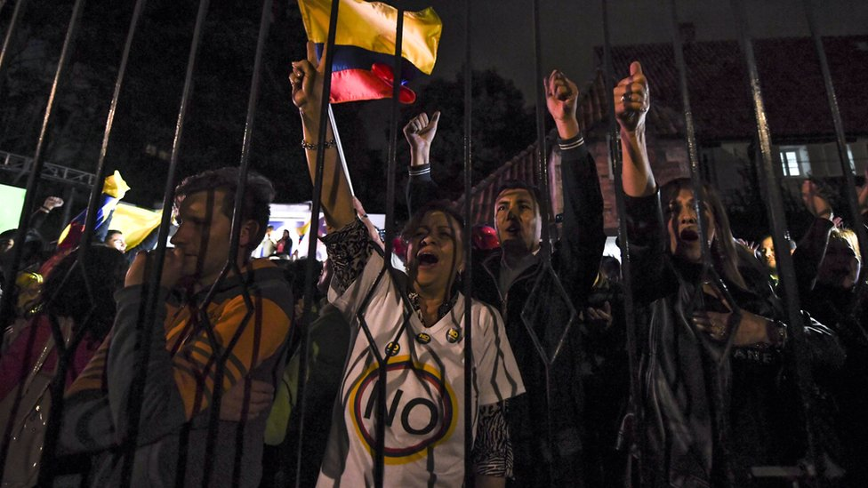 People protest after the first peace deal to end a 52-year war between the state and the communist Farc rebels was rejected, Bogota, 2 October 2 2016
