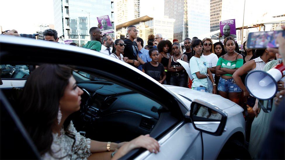Ethiopian Israeli protesters block a road junction in Tel Aviv on 2 July 2019