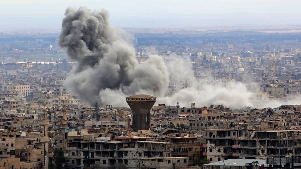 Smoke rises from the besieged rebel-held Eastern Ghouta, Syria, on 27 February 2018