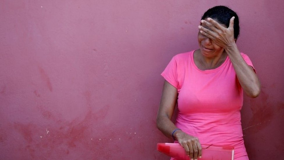 A relative of a prisoner cries after a prison riot, in front of the Medical Legal Institute of Altamira, Brazil, July 30, 2019.