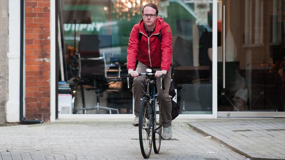 Tim Johns cycling through central London