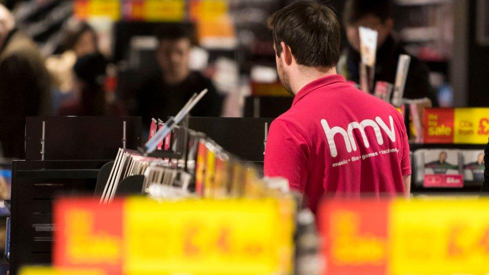 Staff member in a HMV shop