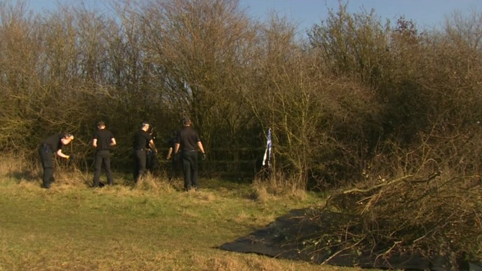 Police searching bushes