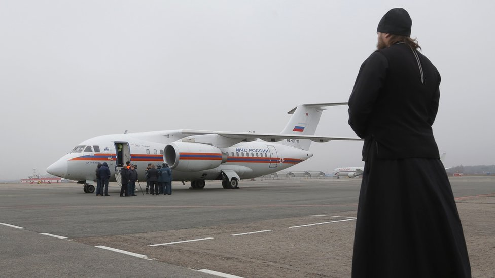 A Russian Orthodox priest at Pulkovo airport in St Petersburg where more bodies of victims of the Russian passenger plane crash are arriving, 6 November 2015.