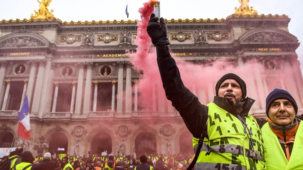 "Protesters gather at Place de l Opera during the ""yellow vests"" demonstration on 15 December."