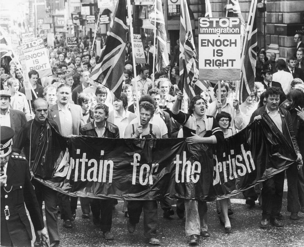 "Meat porters march on the UK Home Office in 1972, bearing a ""Britain for the British"" banner"