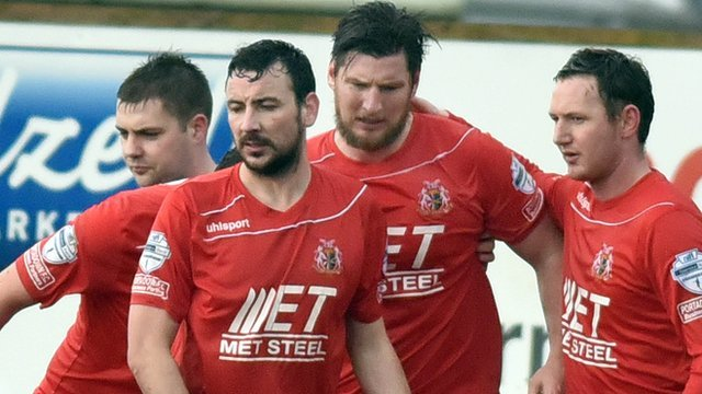 Portadown players celebrate victory over Coleraine in the Irish Cup