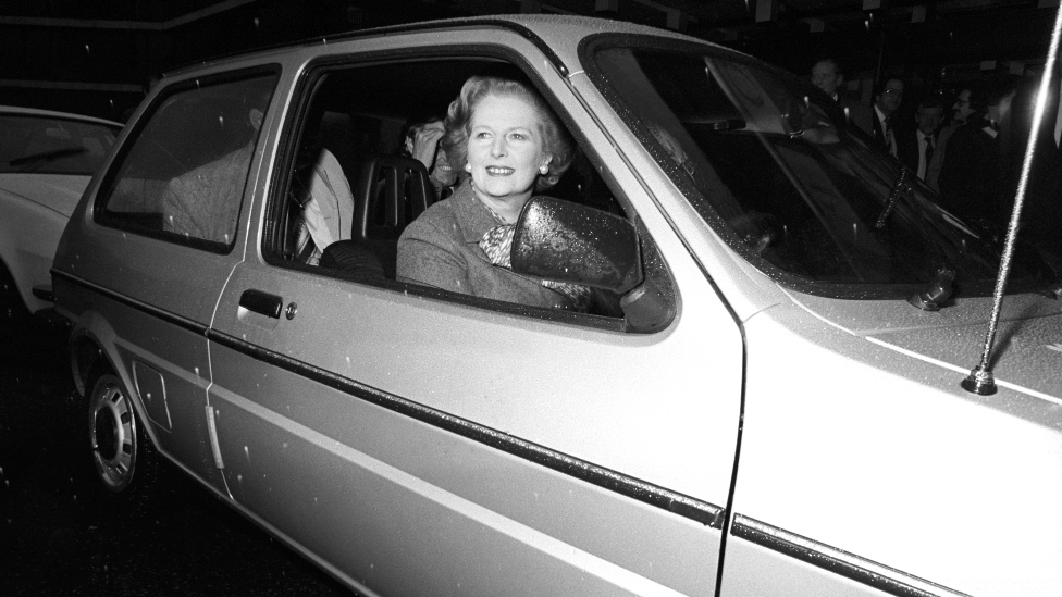 Prime Minister Margaret Thatcher driving a Metro