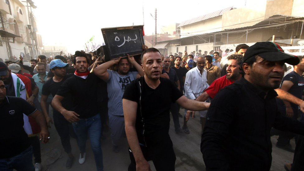 Iraqi mourners carry the coffin of a protester who was killed during clashes in Basra, 7 September 2018