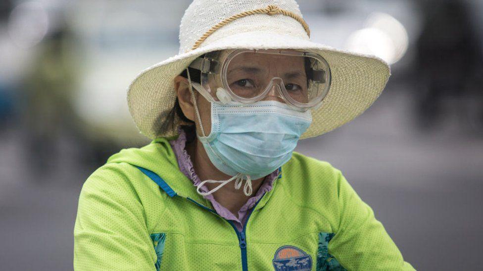 Mujer en Wuhan