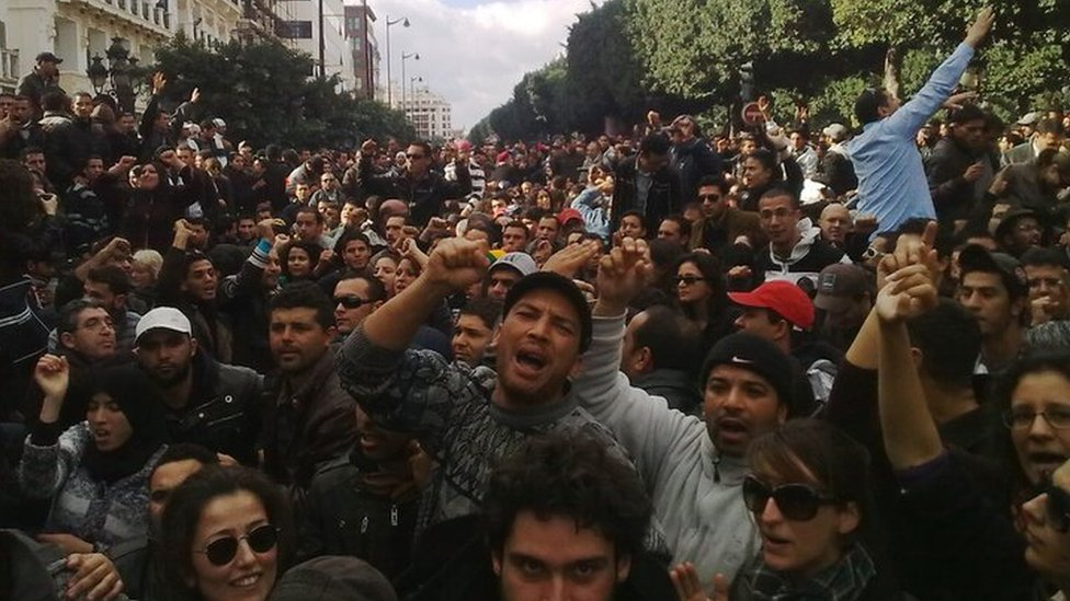 Large crowd of protesters on Avenue Habib Bourguida in central Tunis in January 2011