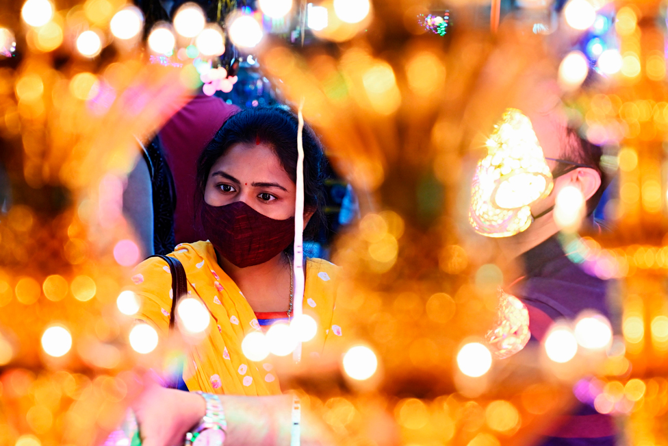 A woman shops for decorative items at a roadside market