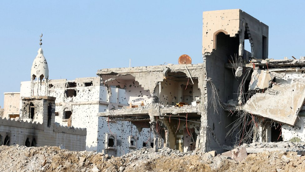 A damaged mosque and remains of buildings in Awamiya, Saudi Arabia (9 August 2017)