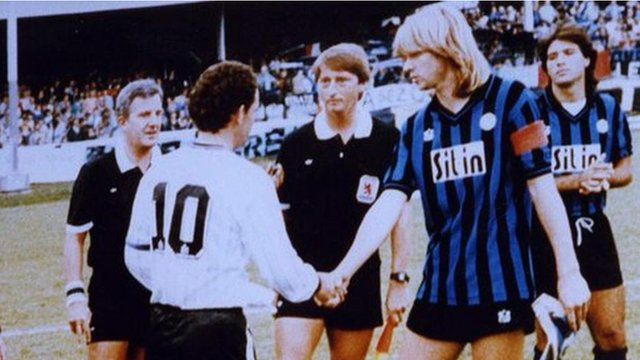 Merthyr Tydfil captain Andy Beattie greets Atalanta's captain Glenn Strömberg at Penydarren Park before the first leg of their tie in the European Cup Winners' Cup