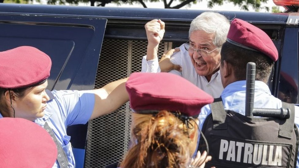 A Nicaraguan man is arrested by riot police during a protest against the government of President Daniel Ortega in Managua on 14 October.