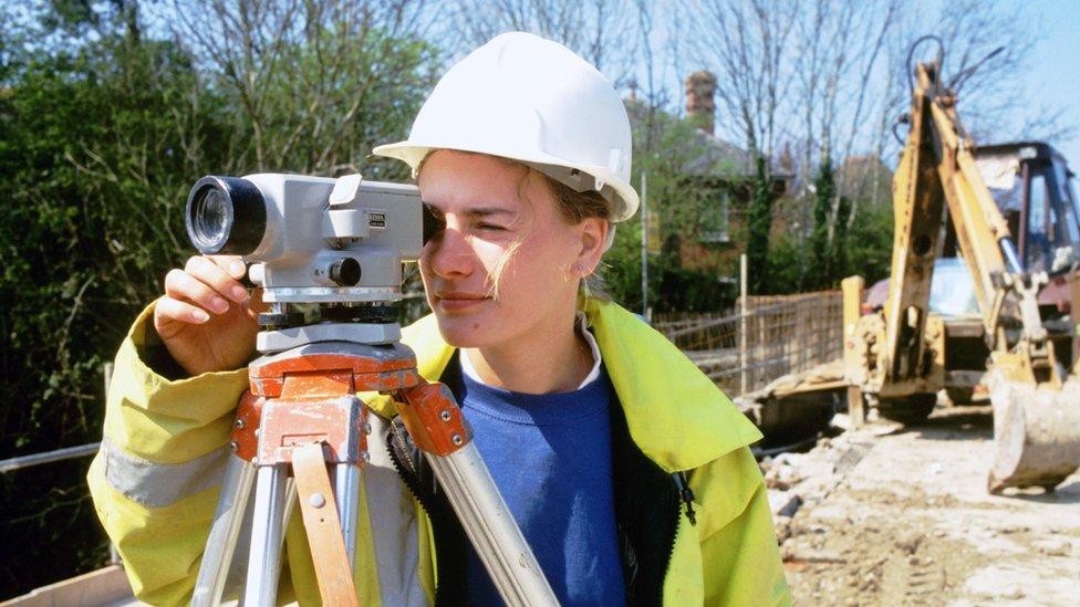 Female civil engineer working on building site