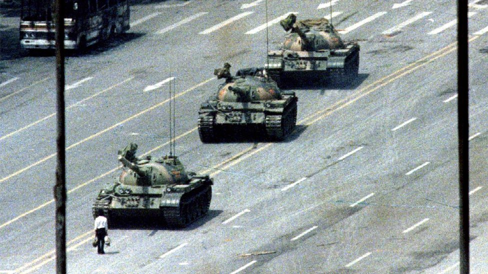 Famous Tank Man image shows a lone man with shopping bags standing in front of a row of tanks