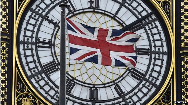 The UK flag flying in front of Big Ben at the Houses of Parliament, London