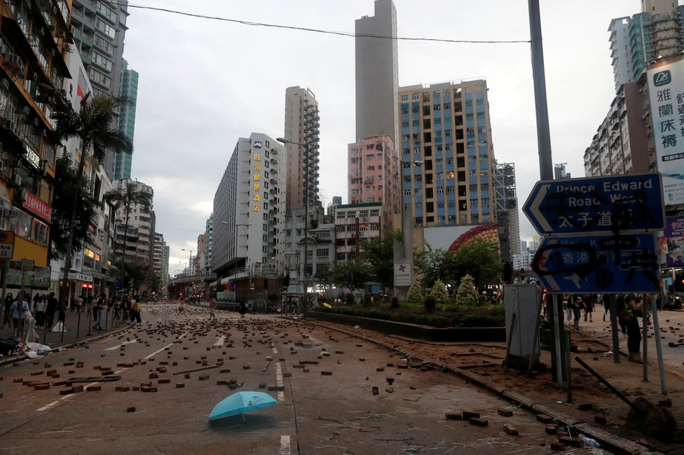 Bricks and debris are seen in a street in Hong Kong, China October 6, 2