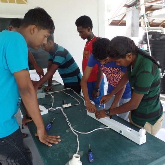 Teenagers take part in an electrical installation class at the Sunrise Center