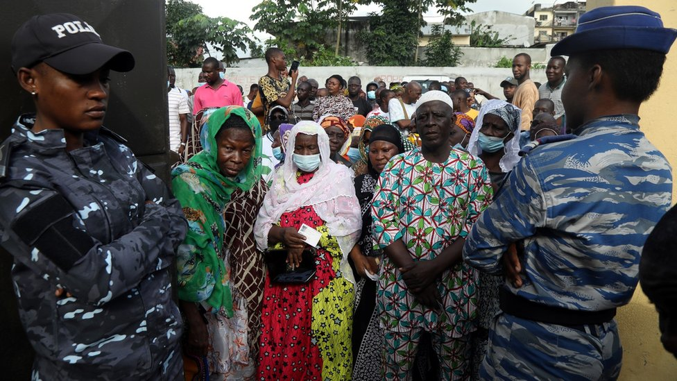 People wait to cast their votes during the presidential election in Abidjan, Ivory Coast, 31 October, 2020.