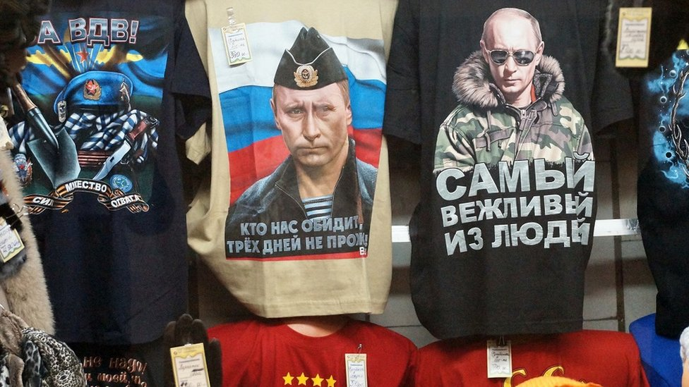 Russian president Vladimir Putin t-shirts on sale in Moscow, Russia, October 2014: