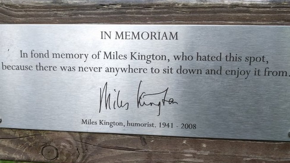 """Bench dedication: """"In fond memory of Miles Kington, who hated this spot, because there was never anywhere to sit down and enjoy it from."""""""