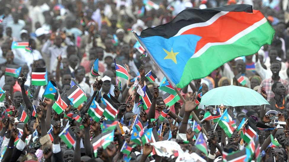 Thousands of Southern Sudanese wave the flag of their new country during a ceremony in the capital Juba to celebrate South Sudan's independence from Sudan