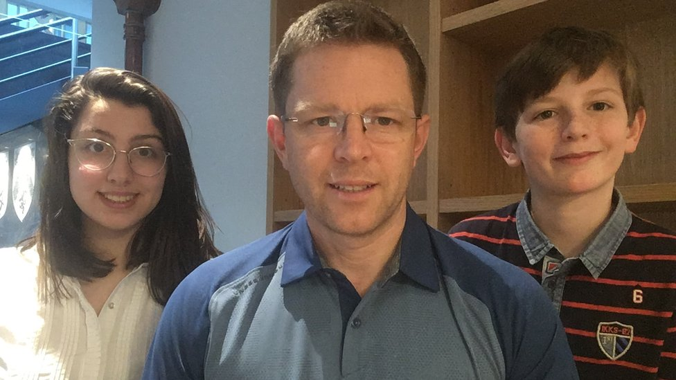 James, who works for an airline in Germany, with his two bilingual children