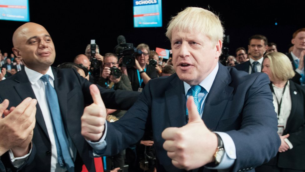 Sajid Javid on the left. Boris Johnson on the right after his speech at the Conservative party conference