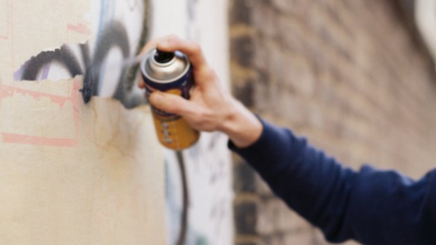 Man spraying graffiti