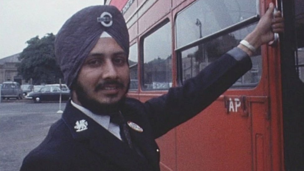 Tarsem Singh Sandhu, wearing his turban with his bus driver's uniform