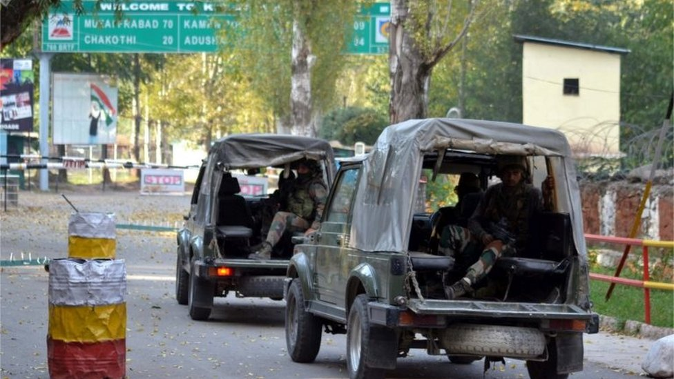 Indian soldiers enter the army base which was attacked by suspected militants in Uri, some 115 west of Srinagar, the summer capital of Indian Kashmir, 18 September 2016.