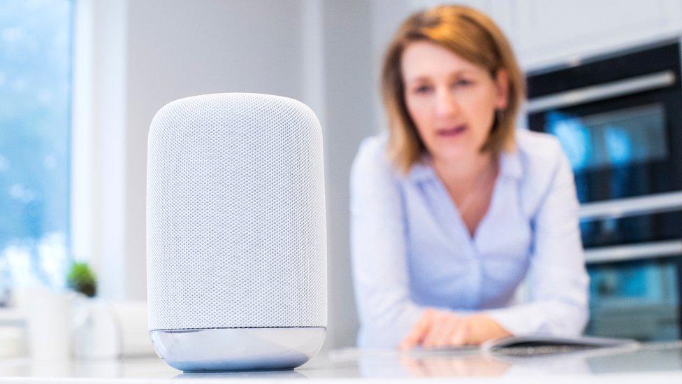 Woman using AI speaker