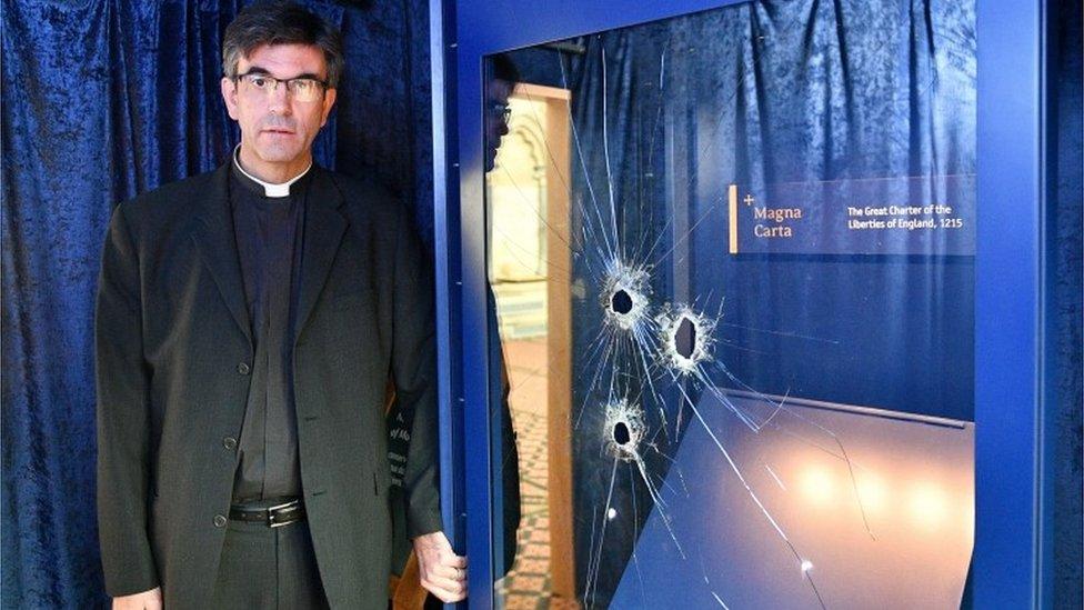 Very Reverend Nick Papadopoulos at the damaged Magna Carta display box