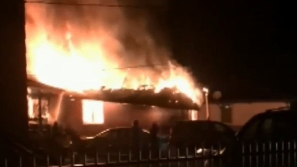 A still of TV footage of the house fire