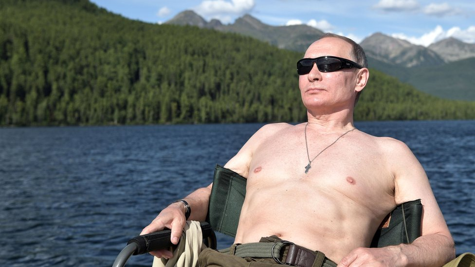 Russian President Vladimir Putin relaxes after fishing during the hunting and fishing trip which took place on August 1-3 in the republic of Tyva in southern Siberia