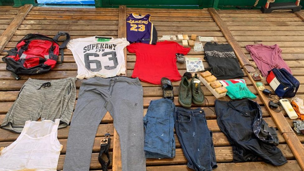 Clothes and other items found inside red rucksack