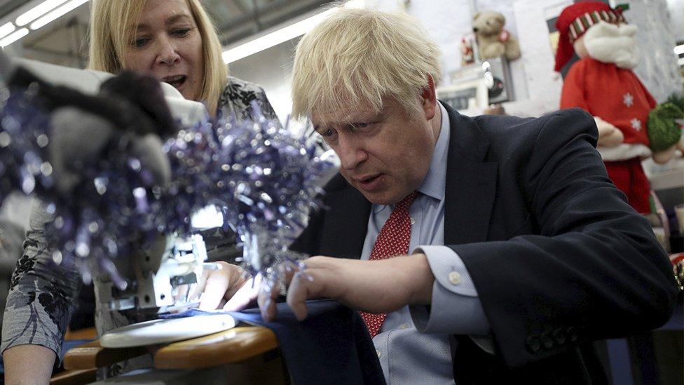 Boris Johnson using a sewing machine