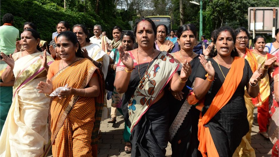 Hindu women devotees and activists shout slogans praising the Hindu God Ayyapa during a protest against the Supreme Court verdict revoking a ban on women's entry to the Sabarimala temple.