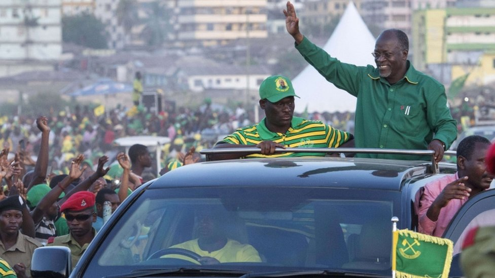 Presidential candidate John Magufuli waves to supporters after addressing a rally by ruling party Chama Cha Mapinduzi (CCM) in Dar es Salaam, Tanzania on October 23, 2015