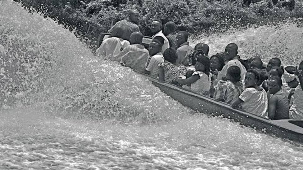 "A photo by Sunmi Smart-Cole entitled: ""Stormy Times In The Niger Delta"" - 2006, showing people on a speedboat in the Niger Delta, Nigeria"